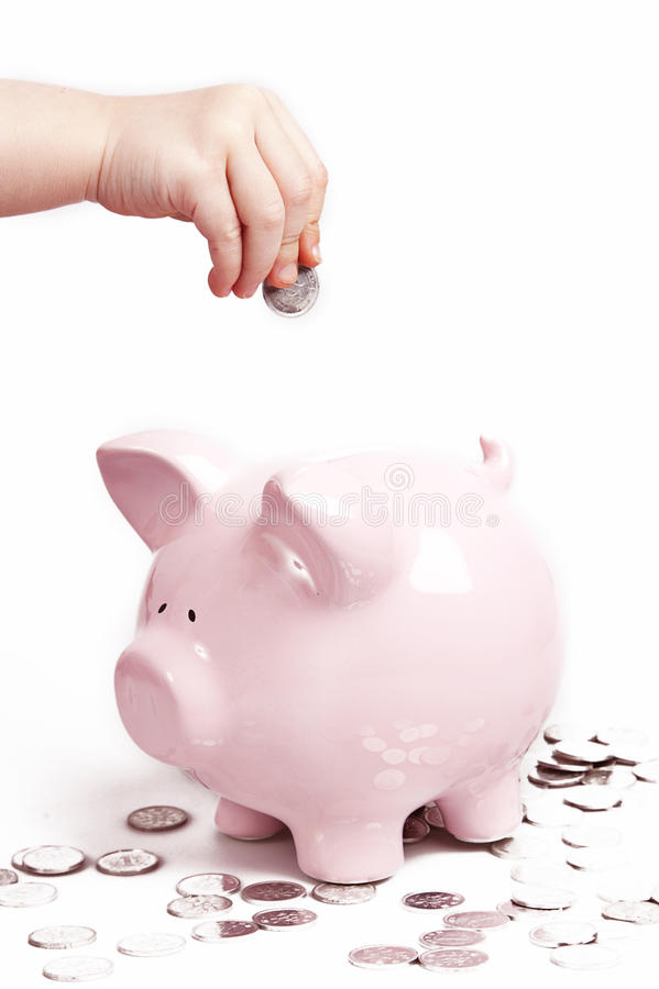 gruppen coins den piggy handen fotografering för bildbyråer