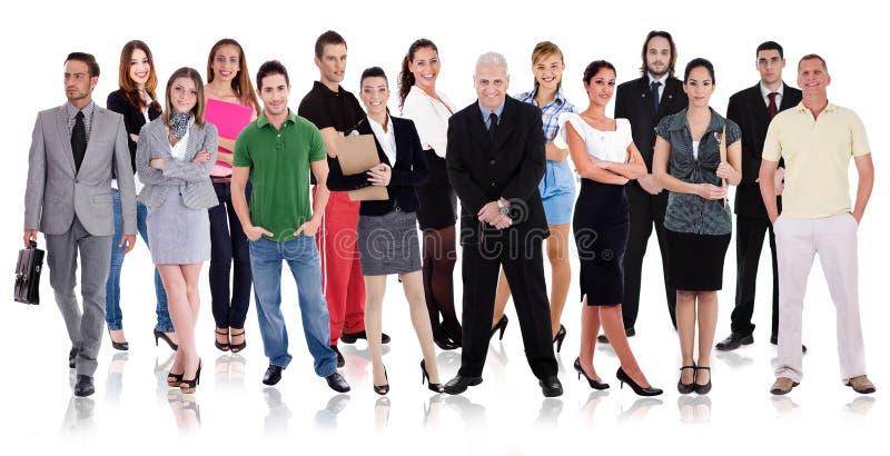 Gruppen der verschiedenen Leute in einer Zeile lizenzfreie stockfotos