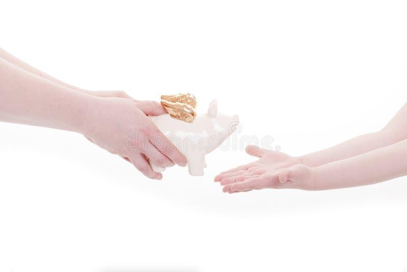 gruppen hands piggy arkivfoto