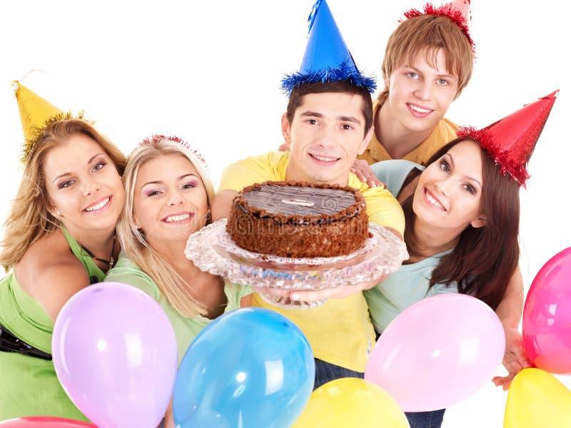 Gruppenleute, die Kuchen geben. lizenzfreie stockbilder