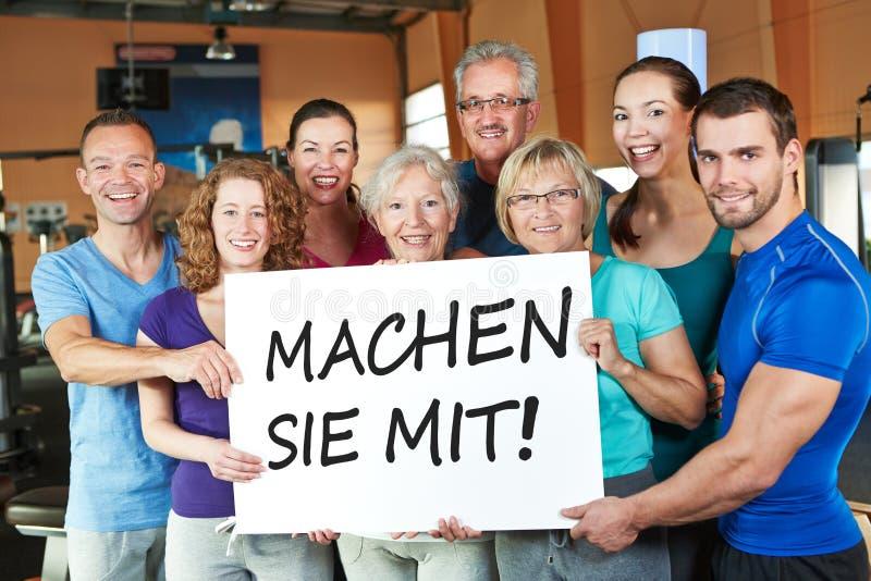 Gruppo che tiene segno tedesco fotografia stock