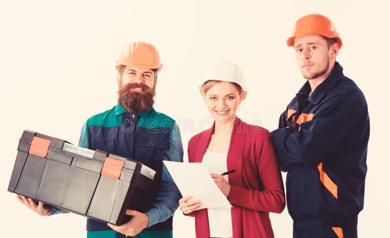Gruppo del concetto degli architetti I costruttori e l'ingegnere lavorano insieme immagine stock