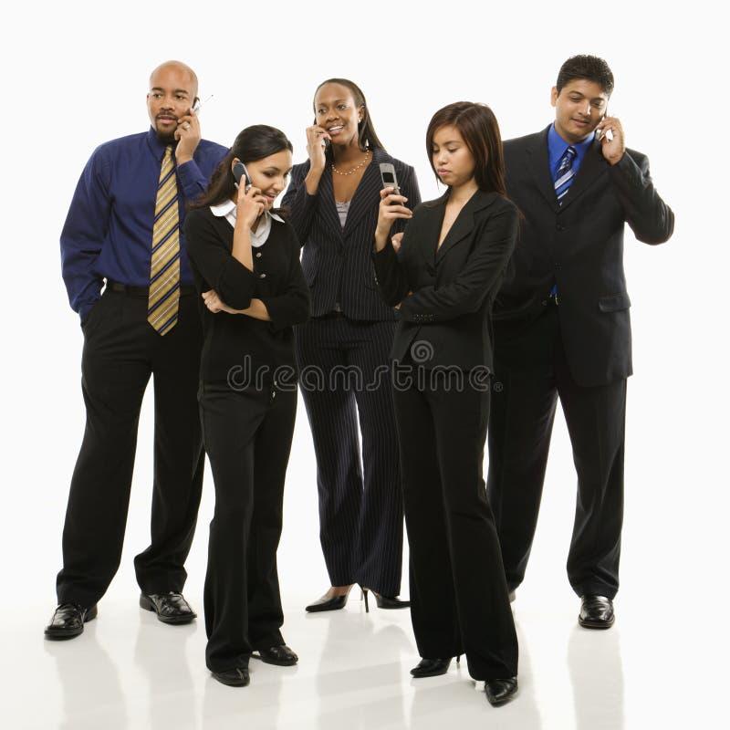 Gruppo di affari con i telefoni fotografie stock