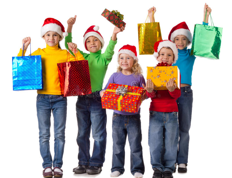 Gruppo di bambini felici con i regali di natale fotografia stock libera da diritti