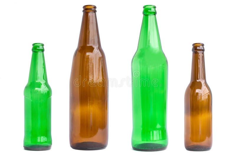 Gruppo di bottiglie di vetro isolate su fondo bianco immagini stock libere da diritti