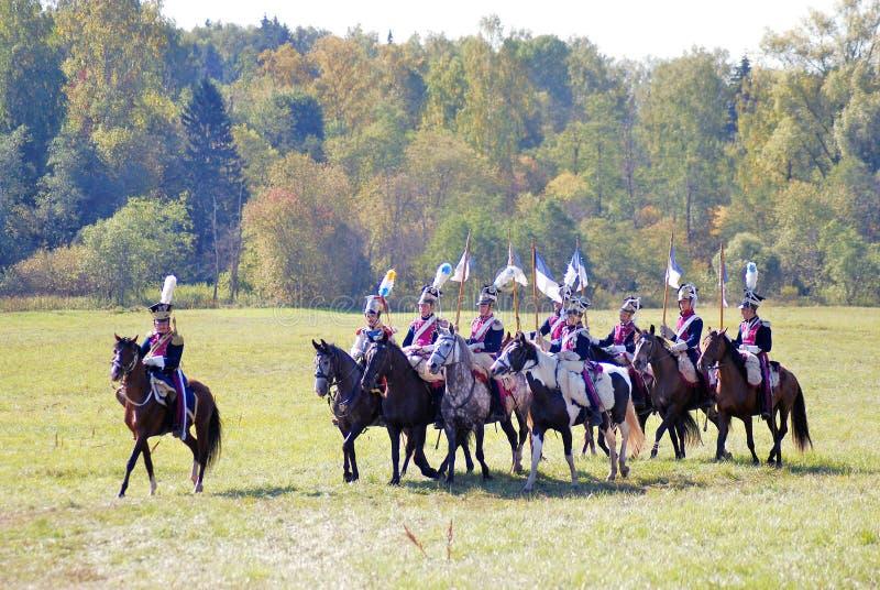 Gruppo di cavalli di giro dei soldati-reenactors immagini stock libere da diritti