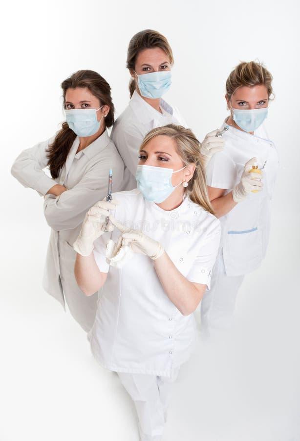 Gruppo di dentisti femminili fotografia stock