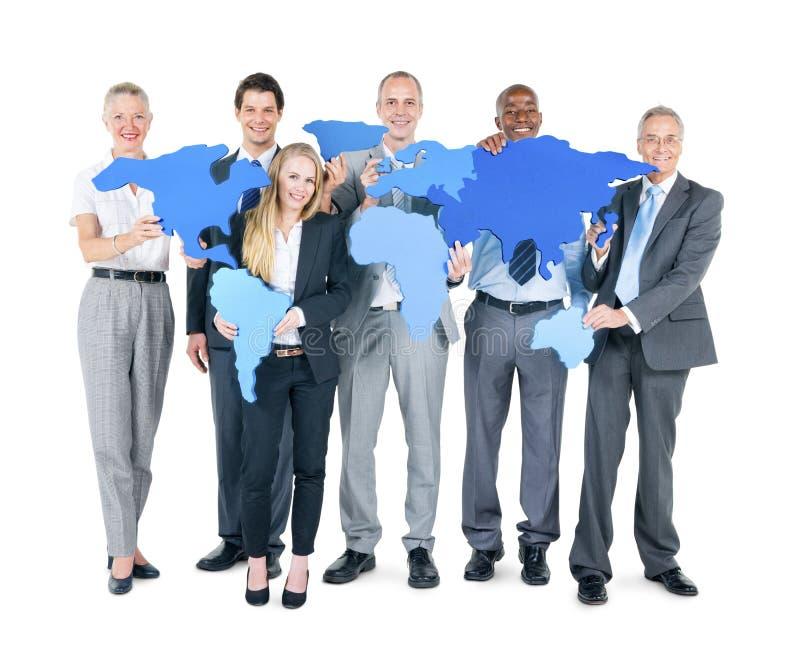 Gruppo di gente di affari con i continenti fotografia stock