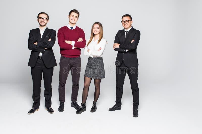 Gruppo di gente di affari sorridente isolata sopra fondo bianco fotografie stock libere da diritti