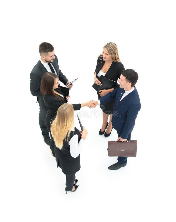 Gruppo di gente di affari che fa stretta di mano Isolato sul BAC bianco fotografia stock