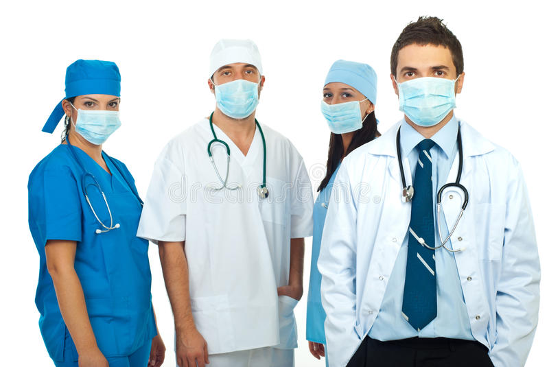 Gruppo di medici con le mascherine immagini stock libere da diritti