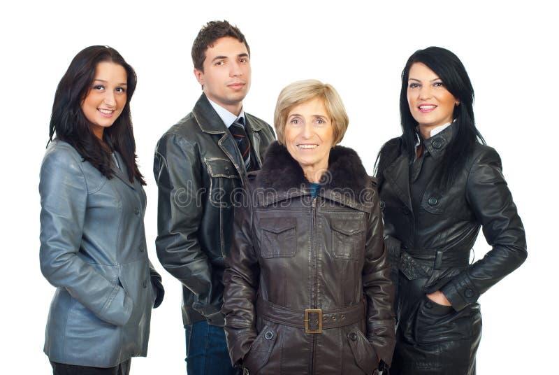 Gruppo di persone in cappotti di cuoio fotografia stock libera da diritti