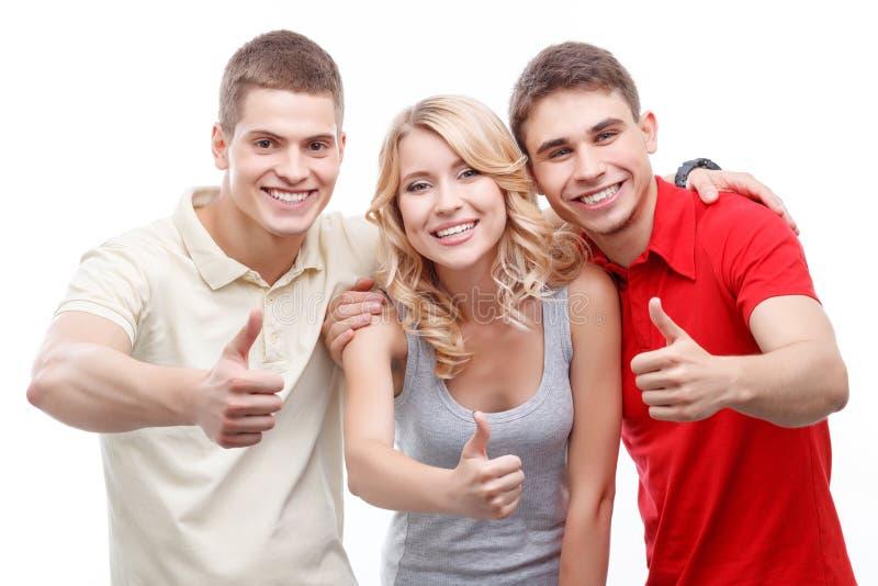Gruppo di persone con i pollici in su immagine stock
