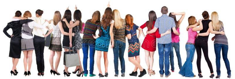 Gruppo di persone posteriore di vista sguardo fotografia stock