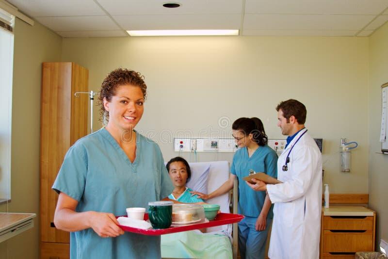 Gruppo di salute con il paziente fotografia stock