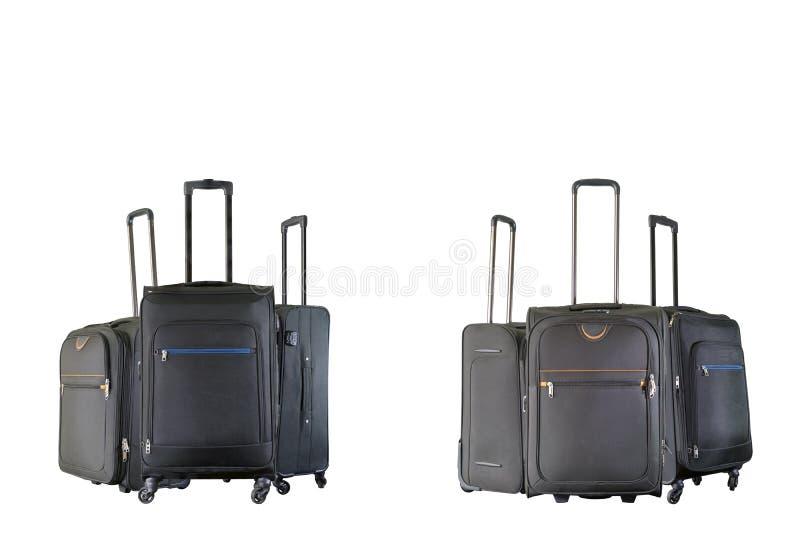 Gruppo di valigie marroni e nere immagini stock