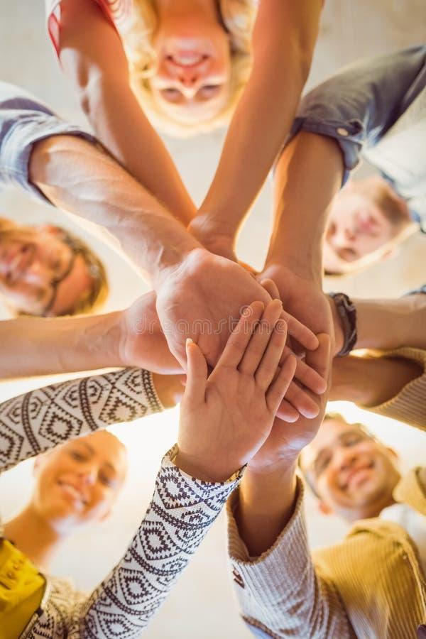 Gruppo felice di affari che unisce le loro mani fotografia stock libera da diritti