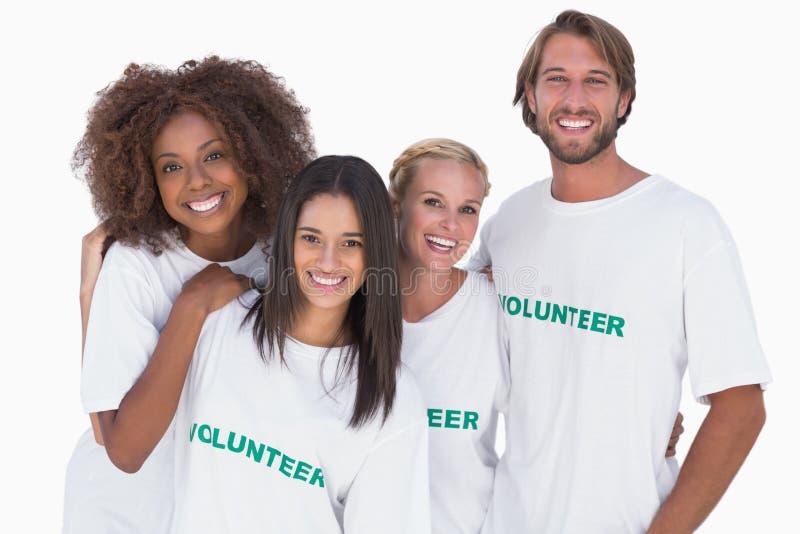 Gruppo sorridente di volontari fotografia stock libera da diritti