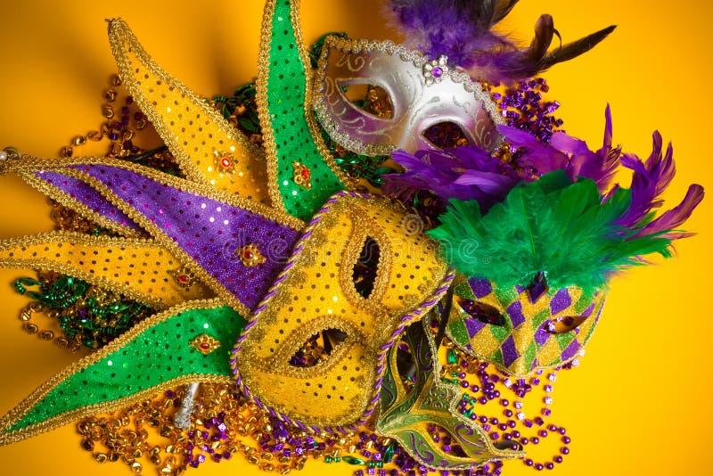 Gruppo variopinto di Mardi Gras o di maschere veneziane  fotografie stock libere da diritti