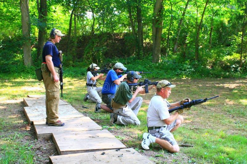 gruppskjutvapen royaltyfria bilder