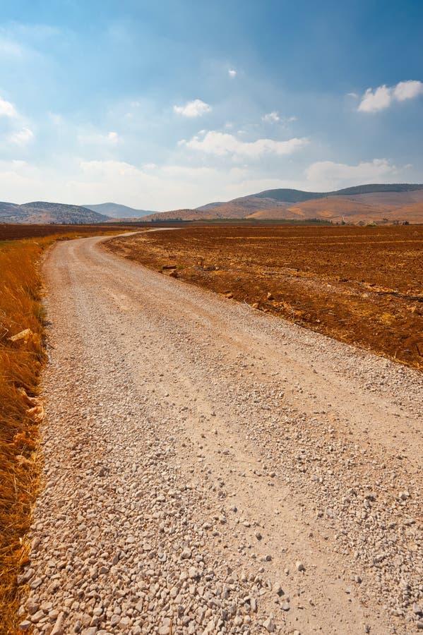Download Grusväg arkivfoto. Bild av öken, kull, jordbruksmark - 27281566