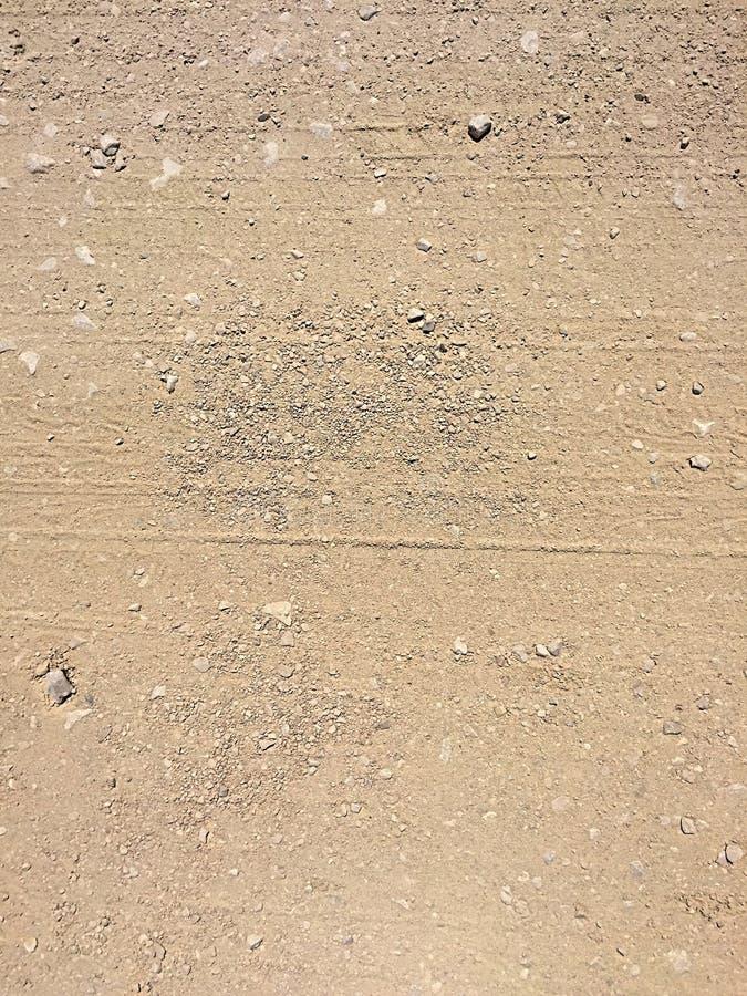 Grusvägbakgrundstextur arkivbild