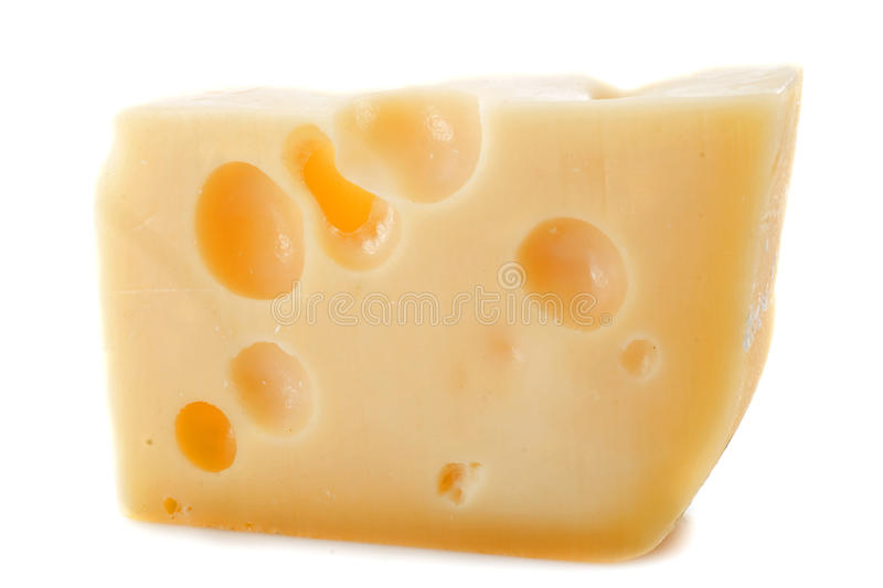 Gruyere. Piece of cheese gruyere in front of white background royalty free stock image