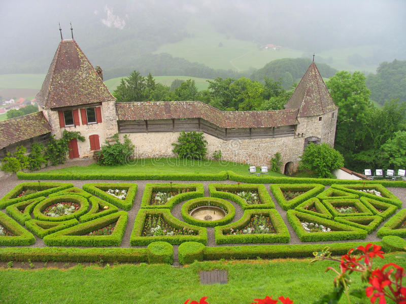 Gruyere castle. On green hill with flowerbed royalty free stock image