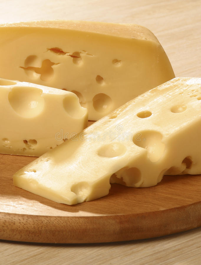 Gruyere cheese. Is sweet but slightly salty, with a flavor that varies widely with age. It is often described as creamy and nutty when young, becoming with age stock images