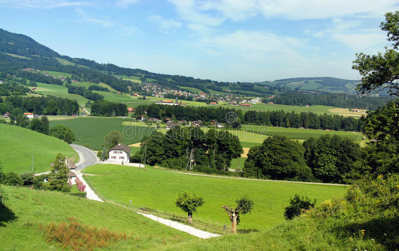 Gruyere region of Switzerland. The homeland of Swiss cheese in summer. View from the village of Gruyere royalty free stock photo