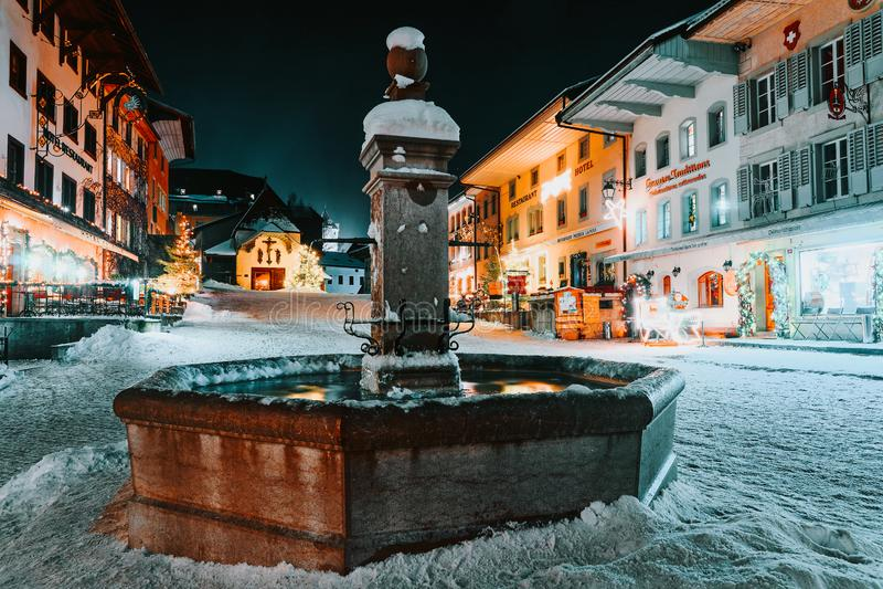 Christmas illumination in snowy streets of Gruyeres. Gruyeres, Switzerland - January 1, 2015: Christmas illumination in the snowy streets of the medieval town of stock images