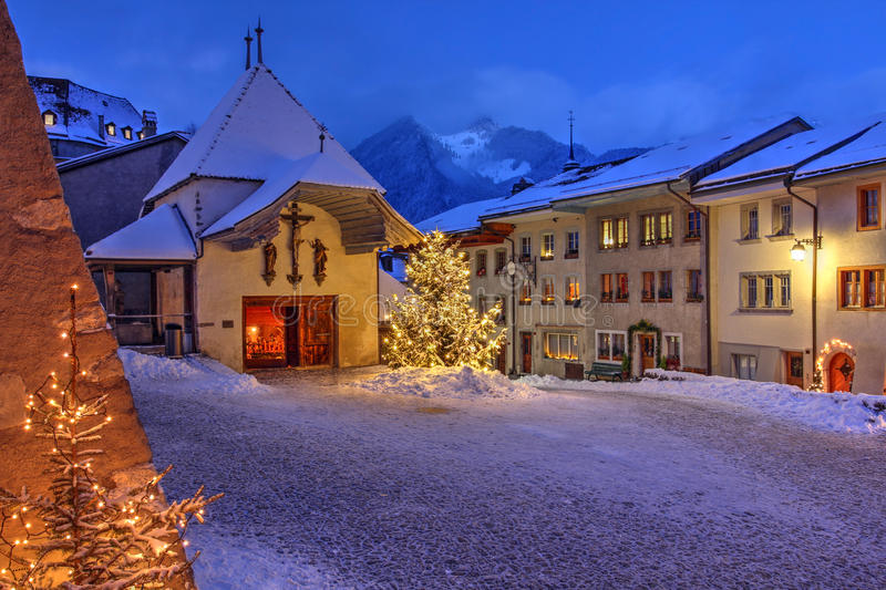 Gruyeres, Switzerland. Winter (Christmas) night scene in the medieval town of Gruyeres, district of Gruyere, Fribourg canton, Switzerland. The town gave the name royalty free stock images