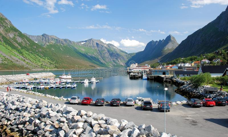 Norway, Gryllefjord, Port with a view of the fjord. Port of Gryllefjord Norway with a view of the fjord with mountains and place. Located in Torsken municipality stock photos