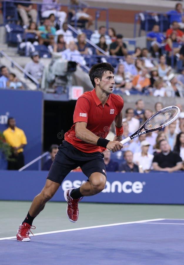 GSix czasów wielkiego szlema mistrz Novak Djokovic podczas pierwszy round przerzedże dopasowanie przeciw Ricardas Berankis przy u zdjęcia stock