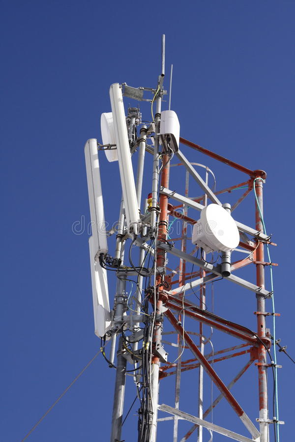 GSM pole in blue sky. Top of a GSM antenna with blue sky as background royalty free stock photo
