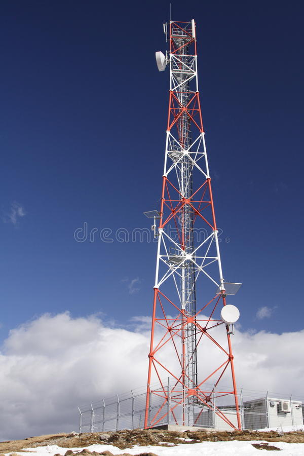 GSM pole in the mountains royalty free stock photos