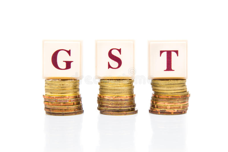 GST or Good and Services Tax concept with stack of coin stock image