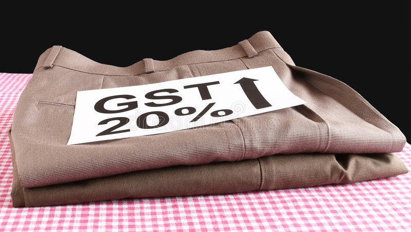 GST-Konzept für gebrauchsfertige Kleider stockbild