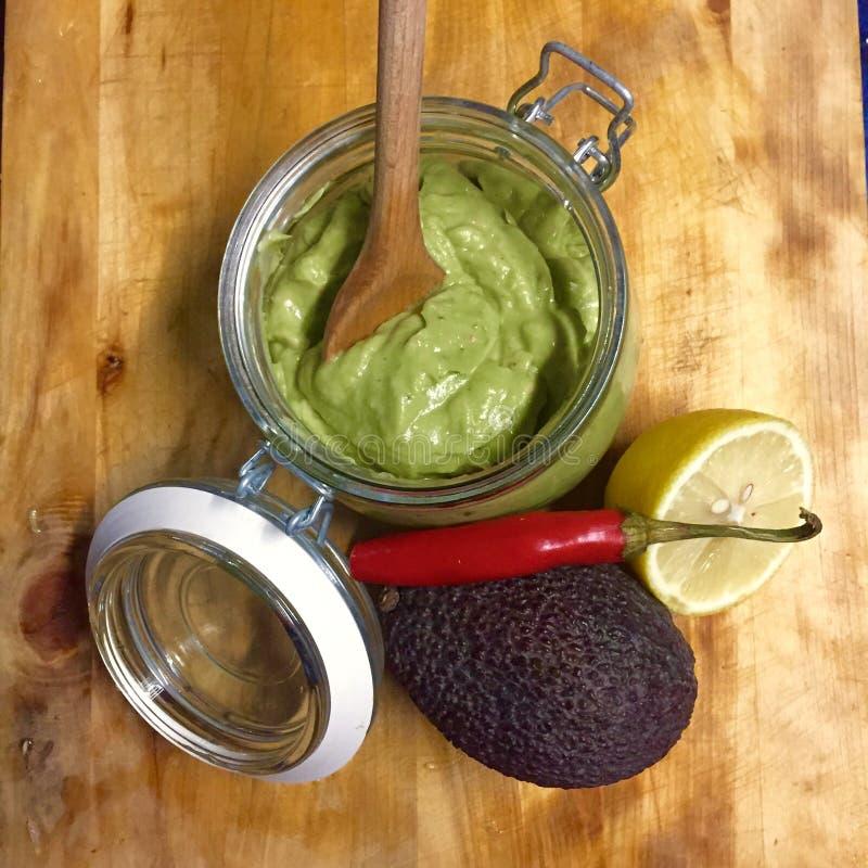 Guacamole. Avocado guacamole with lemon, garlic and chilies stock photos