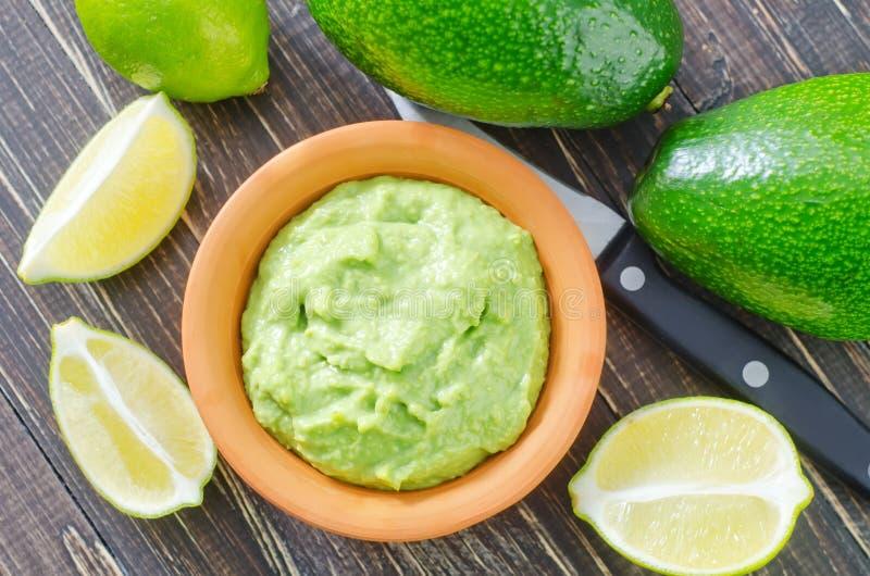 Guacamole. In bowl and fresh avocado stock photo