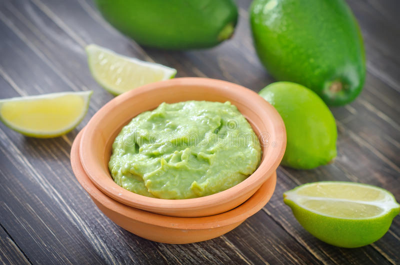 Guacamole. In bowl and fresh fruits stock images