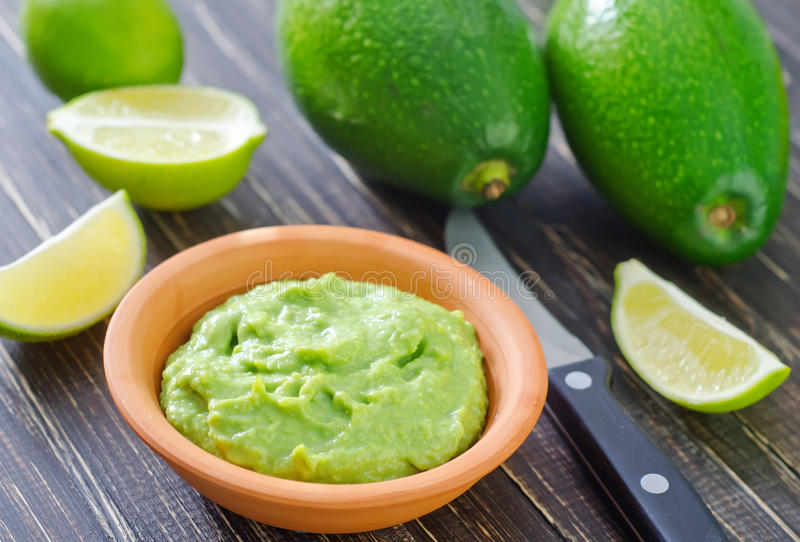 Guacamole. In the brown bowl royalty free stock photo