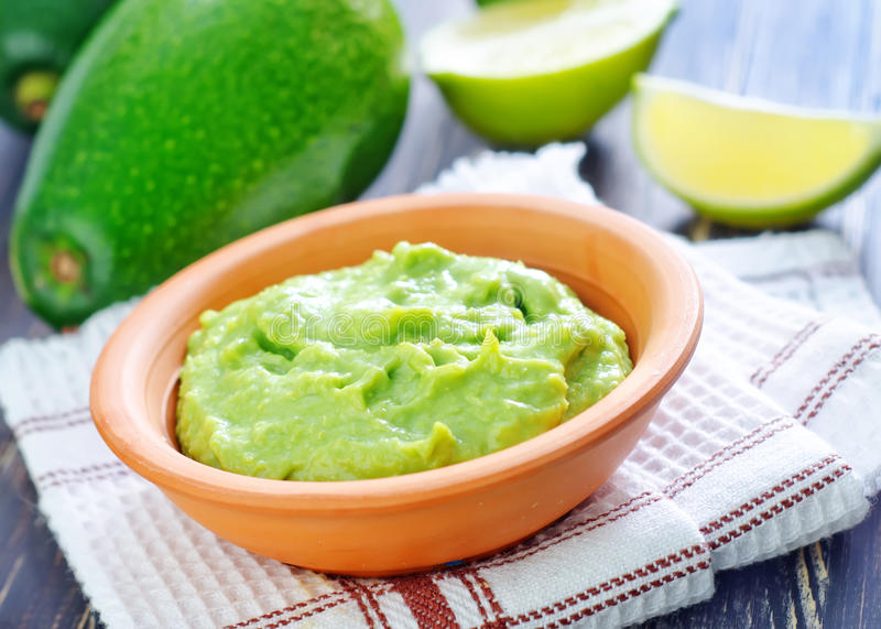 Guacamole. In the brown bowl royalty free stock photography