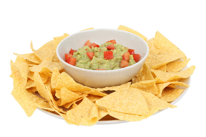 Guacamole and chips. Isolated over white background stock images