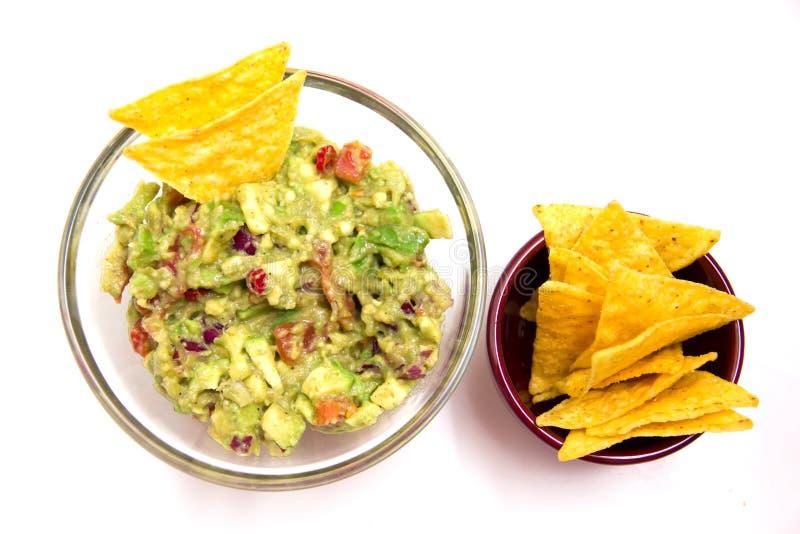 Guacamole e nachos de fotografia de stock