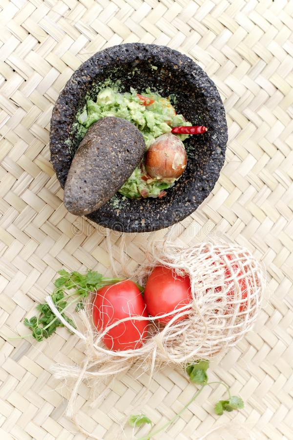 Guacamole in molcajete royalty free stock photography