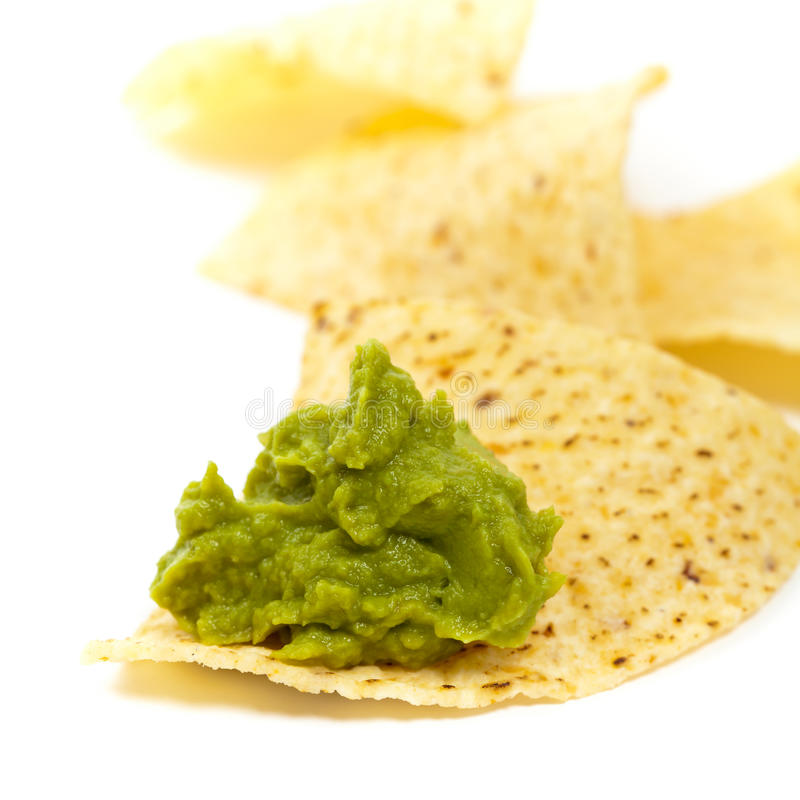 Guacamole and nachos. Guacamole on white background. Selective focus stock images