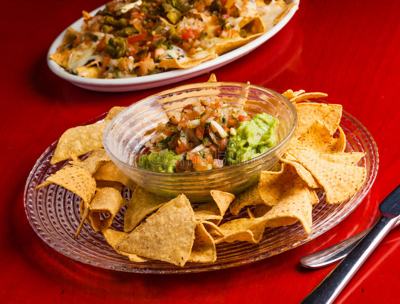 Guacamole with tortilla chips royalty free stock photo