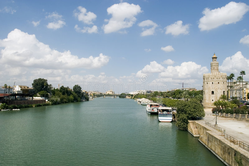 Guadalquivir river. View of the Guadalquivir river in Seville, Spain with tower of gold in the right stock photo