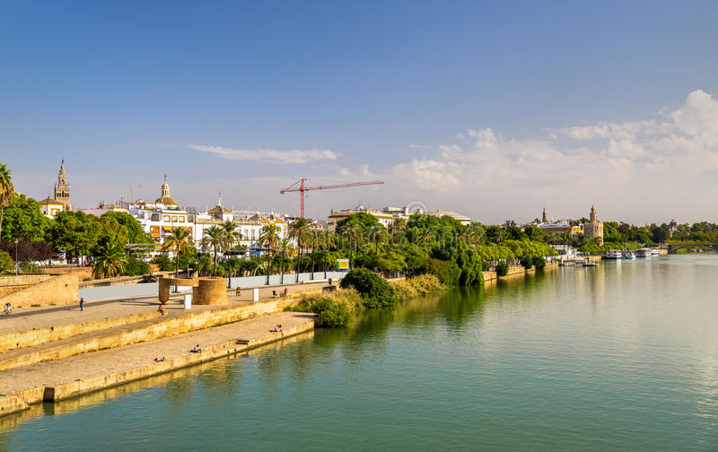 Guadalquivir river embankment in Seville, Spain. Guadalquivir river embankment in Seville - Spain, Andalusia stock photos